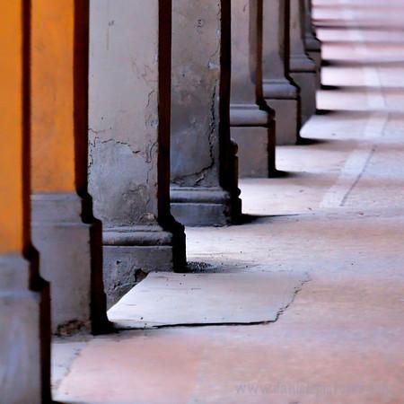 Underneath Bologna's porticos.