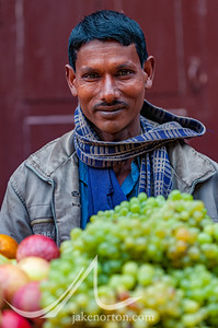 An Indian man selling fruit in the streets of Bhaktapur, Nepal.