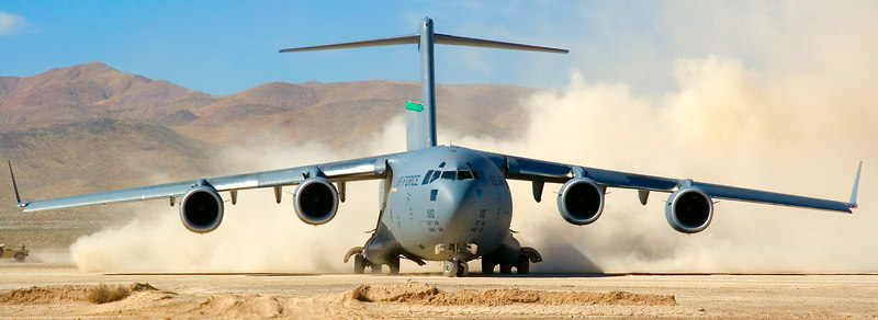 A 62nd Air Wing (McChord AFB, WA) C-17 taxis to the active runway at Bicycle Lake Army Airfield to prepare for takeoff.