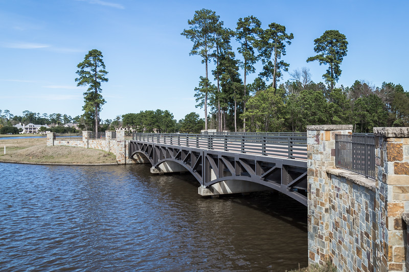 The Private East Shore Bridge to the Island in Lake Woodlands