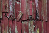 Deteriorating red wooden wall