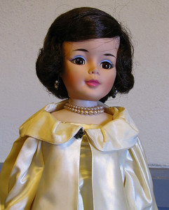 Jackie Kennedy doll in cream satin dress with cape
