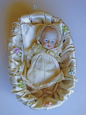5 1/2-inch, German bisque baby in lined basket