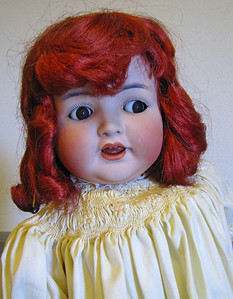 23-inch, German bisque, Kammer & Reinhardt, flirty eyes, red mohair wig, yellow cotton dress