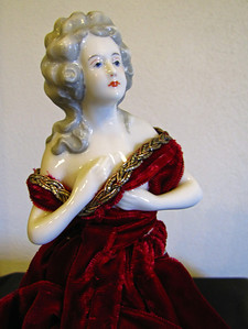 4 1/2-inch, half doll head, German, red velvet dress, no pin cushion
