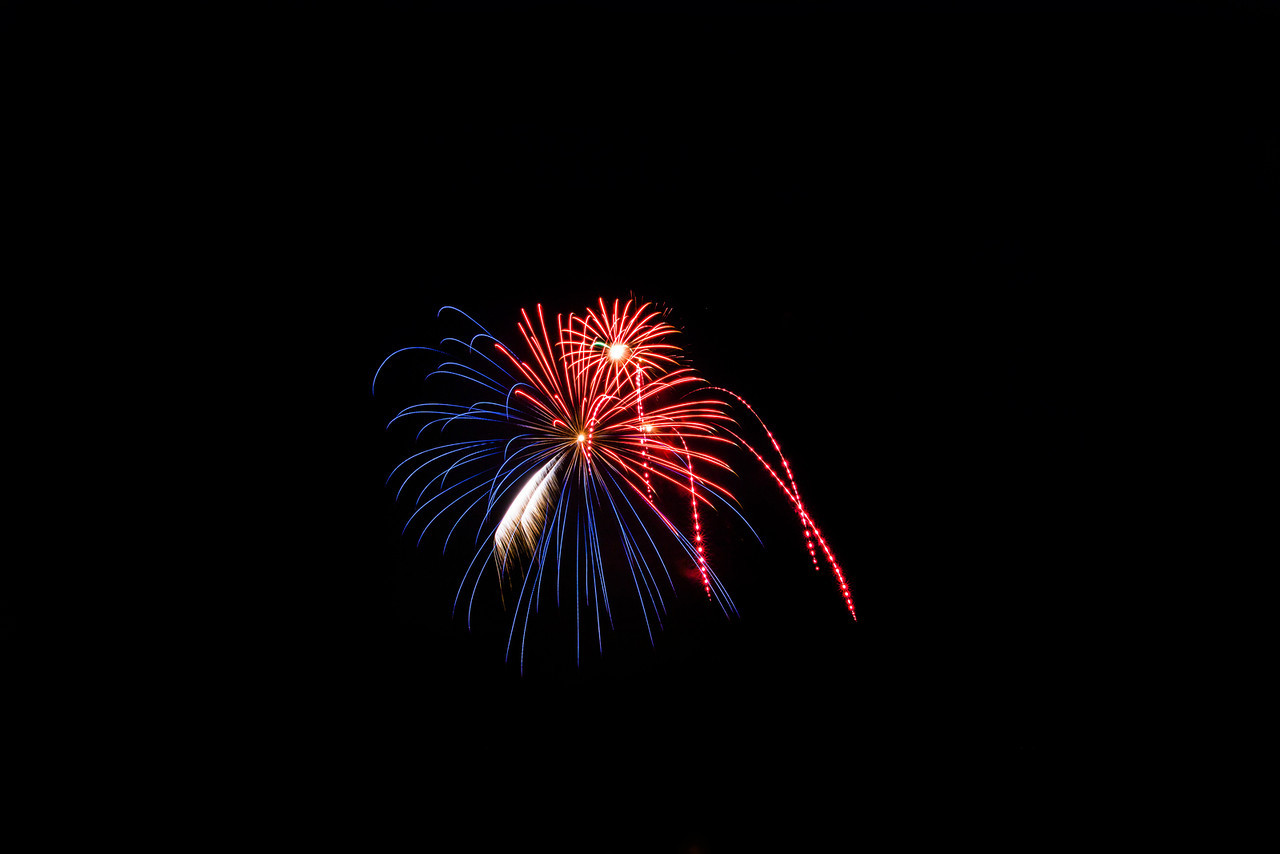 This lonely firework was red, white & blue with a weird shape too!