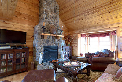 The stone fireplace and bay window.