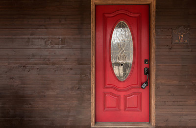 The door was a beautiful red color and really stood out against the dark wood.