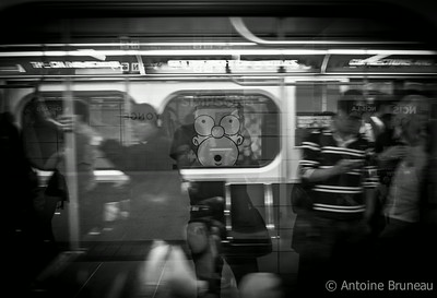 Bloor-Yonge Station. I was waiting for the subway downtown Toronto staring at an advertising poster for the Simpsons TV show when I had the last minute idea to place Homer's face to my reflection as the train arrived.