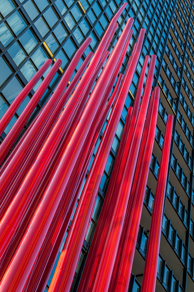 Red pipes structure in front of highrise