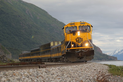 Alaska Railroad passenger train rounding the bend at Beluga Point along the Seward Highway on Turnagain Arm south of Anchorage, AK.  Shot with various focal lengths using Canon 75mm-300mm USM lens on Canon EOS Rebel T2i