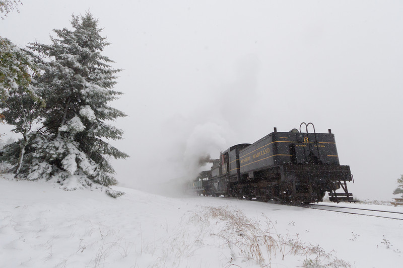 The Cass Scenic Railroad's Western Maryland Shay 6 sits at Bald Knob while snow continues to fall. A total of three to four inches fell over the night.
