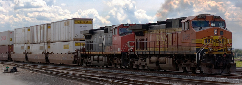 BNSF/CN engines pulling JBHT Intermodal containers