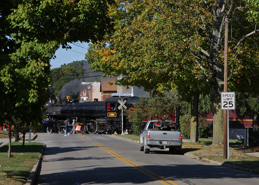 Ohio Central passes through the town of Byesville, OH after pulling the last excursion of the day on the Byesville Scenic Railroad.