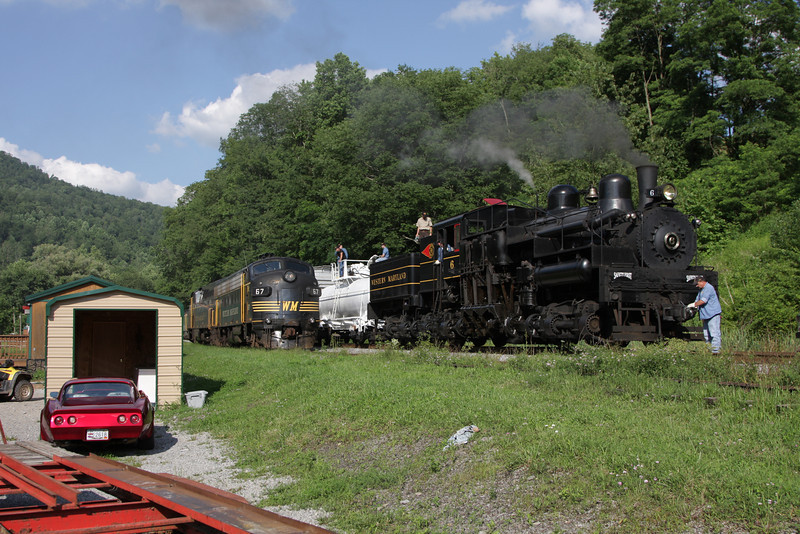 Western Maryland Shay #6 is serviced at Bowden as Western Maryland FP7 67 and WM BL2 82 run around the train on the overgrown siding so they could prepare to pull the train through the Kelley Mountain tunnel. Thursday July 10