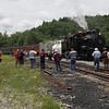 Chasers and passengers flock Shay #6 during a service stop at Cheat Bridge.