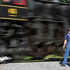 WVC Trainmaster Matt Reese guards the crossing as Shay #6 speeds by.