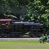 A farmer waves at Western Maryland Shay #6 as it heads towards Belington, WV.
