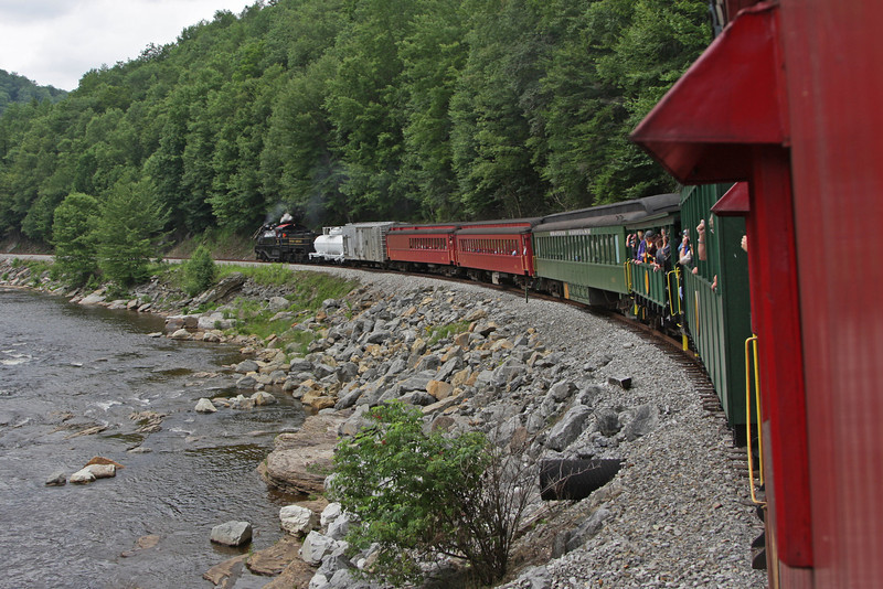 Western Maryland 6 pulls eight cars from both the Cass Scenic Railroad and West Virginia Central along the Cheat river on its way to Elkins, WV.