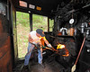 Fireman Chris Lambert shovels coal into the firebox of Big Six on the way to Bald Knob
