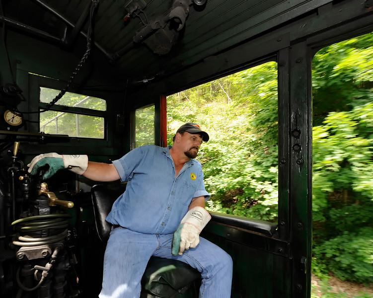 Engineer Danny Seldomridge keeps an eye on the tracks ahead on the way back to Cass