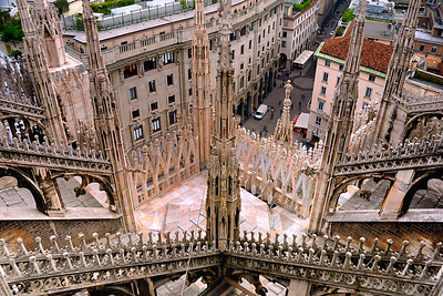 Resplendent Architecture © 2004 Colleen M. Griffith. All Rights Reserved.  This material may not be published, broadcast, modified, or redistributed without written agreement with the creator.  This image is registered with the US Copyright Office.   www.colleenmgriffith.com www.facebook.com/colleen.griffith  The entire structure of the Milano Duomo is covered in pink marble.  This is a view from the roof of the cathedral, looking down into the city streets.