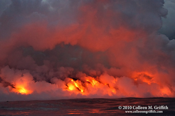 "Water On Fire© 2010 Colleen M. GriffithFriend me on FacebookThis is the main lava flow as it empties into the ocean.  You can't really see the scale of the eruption in this shot, but about 15 feet of the ""shore"" is captured here.  You can see the steam created when the molten rock hit the ocean - it would sometimes obscure the lava flows - but it was like a dance, when the steam cloud would part for a few minutes allowing us to glimpse the lava beneath it.Photo taken August 23, 2010 - it captures lava flowing from the Kilauea volcano on The Big Island of Hawaii."