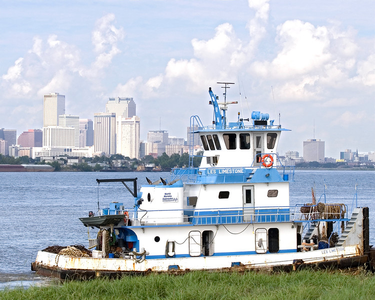 New Orleans from across the river, Tug Les Limestone passing