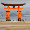 """""""Low Tide""""<br /> Tourists visit the O-Torii (Grand Gate) of the Itsukushimajinja Shrine at low tide, on a cloudy day. Reflections of the gate can be seen in the water left by the receding tide. Miyajima, Japan."""
