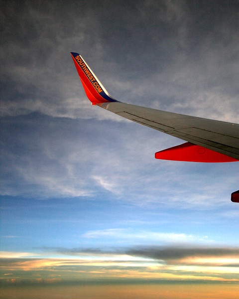 """Southwest Airlines wing at sunset """"the sea was red and the sky was grey"""""""