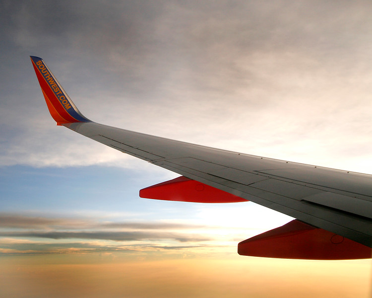 """Southwest Airlines wing at sunset """"going to California"""""""