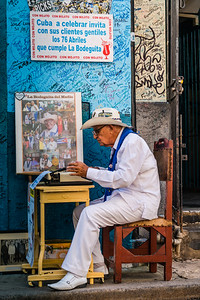 Man using typewriter in Cuba