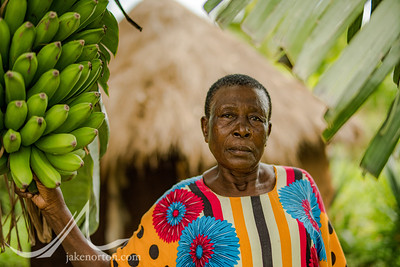 A farmer in Sigomere, rural western Kenya, poses near her banana tree on her subsistence farm.