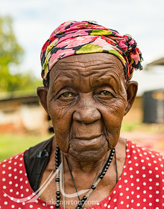 An elderly woman in the village of Sigomere, rural western Kenya, stands outside her family farm.