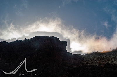 Clouds, light, and shadow on the western breach wall of Mount Kilimanjaro, Tanzania.