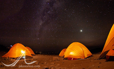 The Milky Way rises over tents on Shira Plateau on Mount Kilimanjaro, Tanzania.