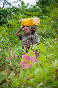 Children hauling water outside of Fort Portal, Uganda.