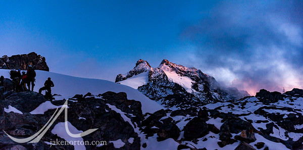The twin Mount Stanley summits of Alexandra (left) and Margherita (right) rise from the upper ramparts of Mount Stanley at sunrise; Rwenzori Mountains, Uganda.