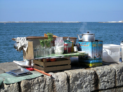hot beverage vendor's stand on corniche wall, Alexandria, Egypt