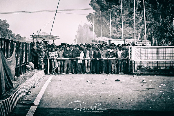 I'm safe - these spectators were blocked from entry to the already packed stadium where the daily closing parade took place at the border between India and Pakistan