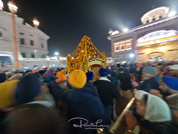 The holy book was placed and carried in a (don't know what your call) and is installed in the temple every morning and returned at night to the Akal Takhat