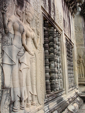 apsara dancer and window carvings on Angkor Wat