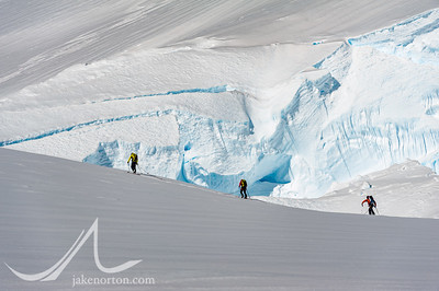 Peter Whittaker, Seth Waterfall, and Caroline George ski off across the Branscomb Glacier in search of lines.
