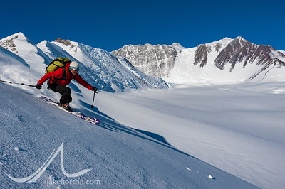 Caroline George making tracks in Antarctica with Vinson Massif in the background.