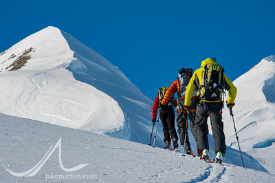 Peter Whittaker, Seth Waterfall, and Caroline George skin up slopes on the shoulder of Mt, Vinson, Antarctica.