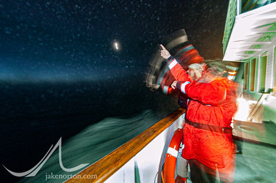 Naturalist Tom Ritchie points out stars and landmarks from the deck of the M.S. Endeavour as it sails through rough seas in the South Atlantic from Puerto Madryn, Argentina, to South Georgia.