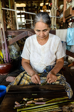 Burmese lady prepares Lotus threads