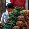 Burmese woman selling pineapples