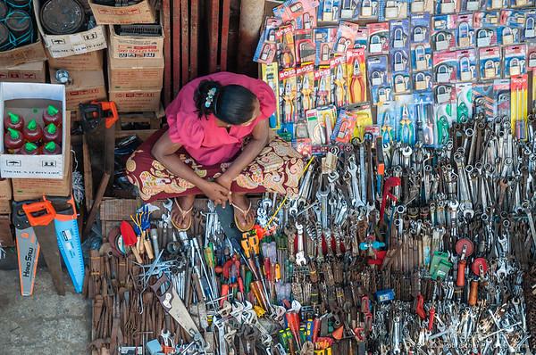 Burmese woman selling tools