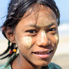 young burmese girl with thanaka makeup